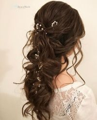 Half up half down bridal hairstyle Get inspired by