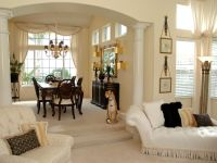 This large adjoining living room and dining room area is ...