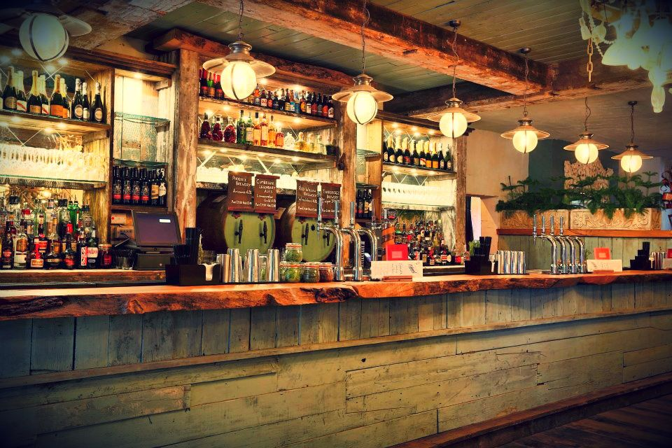 Back Bar Designs  the botanist alderley bar chandelier made from an old rusty wheel and