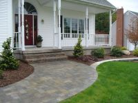 curved walkway from driveway to front door