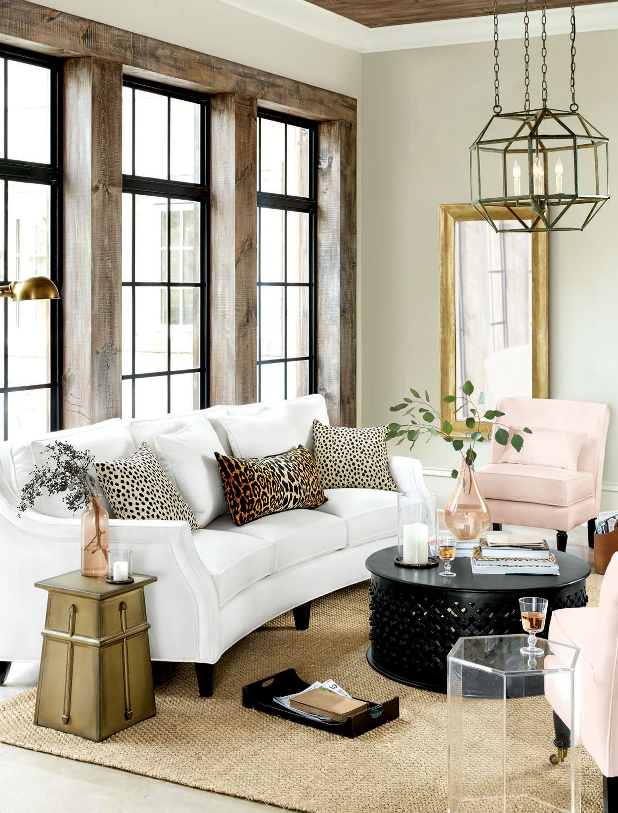 few animal print throw pillows bring playful modern edge to this living room also rooms and rh pinterest