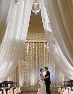 love this backdrop indoor wedding ceremony elegant arch decorations created out of hanging flower cascade in graduated lengths also style the aisle incredible ceremonies part ii rh pinterest