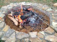 DIY firepit. Bricks, sandstone and a gravel base dug deep ...