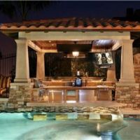 Outdoor kitchen with a swim up bar u can sit down in the ...