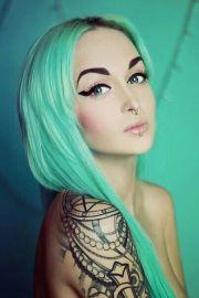 green hair pastel tattoogirl