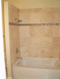 updating bathroom ceramic tile. around tub