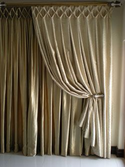 Beautiful header on these curtains large smocking Maybe