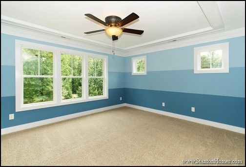 Three Shades Of A Soft Blue Paint Give A Beach House Feel To This