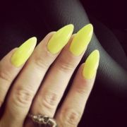 yellow manicure claw nails polished