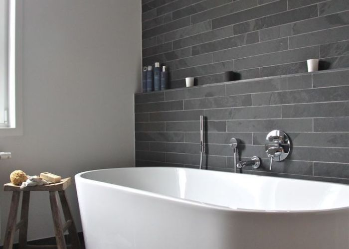 think watching this tub fill with water would be  pleasure unto itself bathroom white vanity and toilet  black tile back pinterest black tiles also