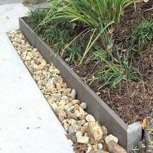 Trench With Gravel Separating Sidewalk From Bed Edging For The