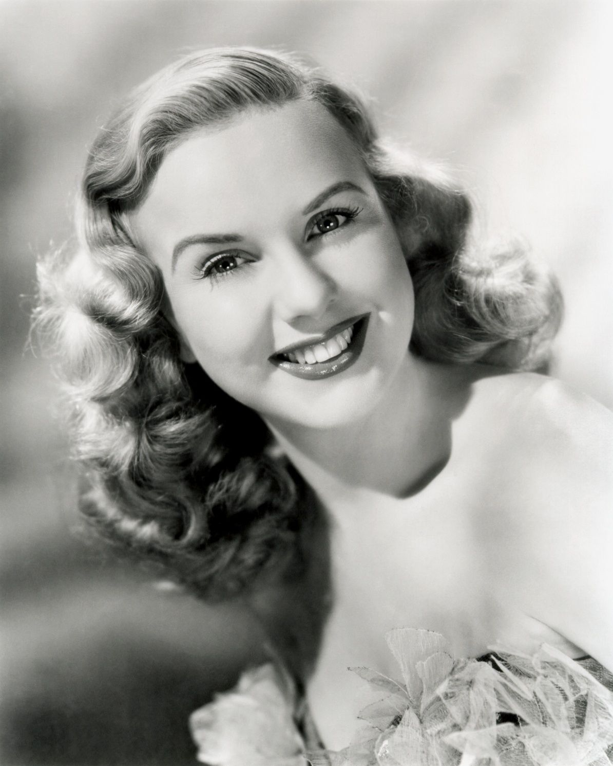 Deanna Durbin Sports The 1930s Long Finger Wave Style With Loose