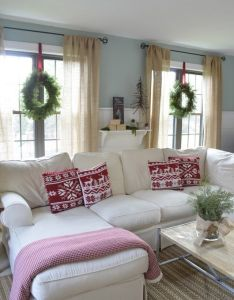 Love the idea of hanging wreaths with ribbon inside on windows great christmas decorating tip couch for living room also rh pinterest