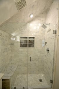 Tiny Bathroom Remodel features carrara marble shower with ...