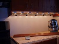 Under cabinet plug molding and lighting.