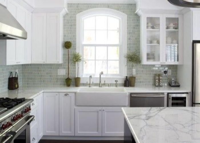 farmhouse sink carrera marble countertops beautiful wood floors and crackle ceramic subway tile backsplash what   not to love about this kitchen also very close my will be same dark with white