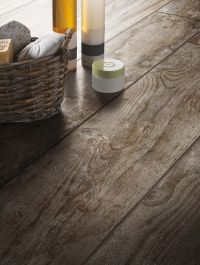 These rustic wood look tiles from the Daltile Season Wood ...