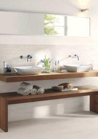 Floating vanity with raised vessel sinks create a sleek