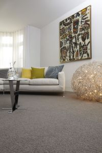 Grey wool carpet creates a good base for bright ...