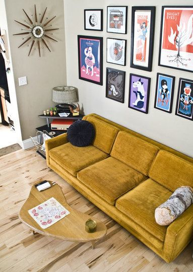 Accented   graphic art wall gallery this mustard yellow couch is so cute wooden floors  an unique coffee table top off retro design also posters using black frames decor pinterest mid century rh