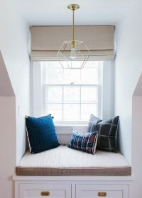 Bedroom dormer window alcove is filled with a built-in ...