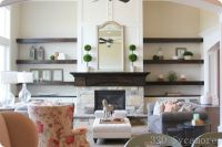 modern floating shelves and cabinet around fireplace ...