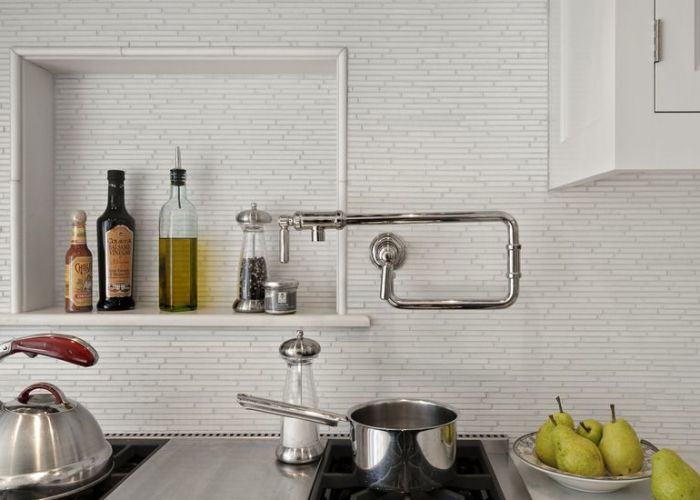 White carrara marble tiles in  random brick mosaic make beautiful alternative to subway the kohler pot filler faucet is also great tool not fan of tiny tile but this pretty close up from far away nz