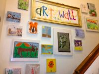 Kids art wall using cheap plastic frames that we used to ...