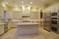 Example of light countertops, cabinets, and travertine ...