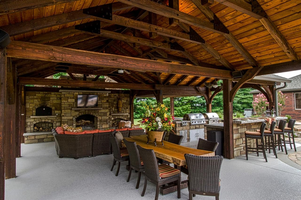Outdoor Living Space Is Complete With Fireplace Kitchen