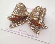 oversized gold glitter hair bow