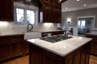 Classy Black Gas Stove Top On White Cambria Quartz Granite ...