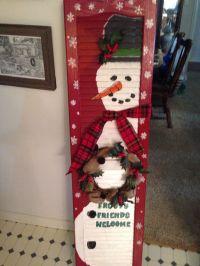 Old shutter painted a snowman. Wreathsbymonica