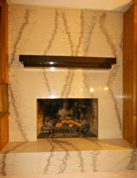 Beautiful fireplace remodel done by Granite ...