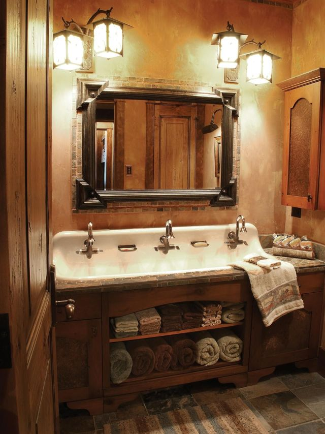 A cast iron trough sink with three faucets adds antique flair to