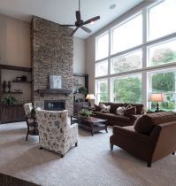 Floor to ceiling stone surround gas fireplace with custom ...