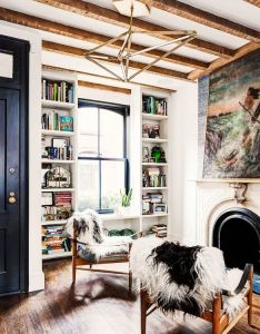 Floor to ceiling bookshelves flanking  window also inside small brooklyn townhouse with major style shaggy rug rh pinterest
