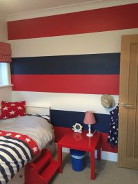 Striped feature wall. Red and blue boys bedroom