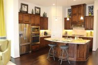 model home with knotty alder cabinet doors large island ...