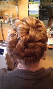 beautiful updo with barrel curls