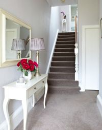 White Traditional Hallway with Taupe Carpet and French ...