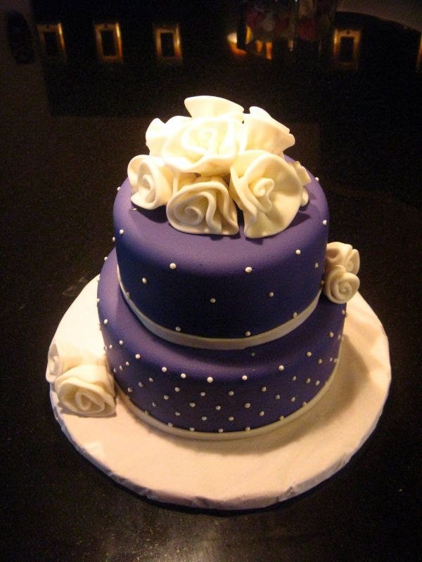 Purple Cake With White Icing Accents And Ribbon
