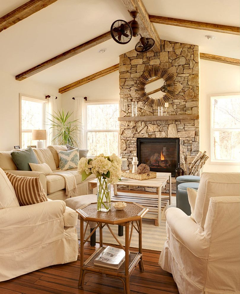Vaulted ceiling with wood beams, natural stone fireplace