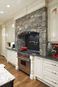 Stone surrounds gas cooking stove in this traditional ...