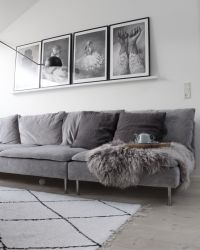 Cool Scandinavian inspired living room with a grey velvet ...
