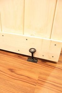 Barn Door: A floor guide from Home Depot keeps the bottom ...
