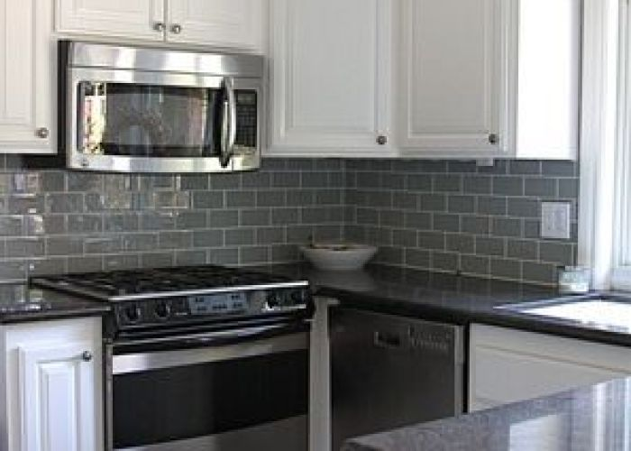 After kitchen cupboards painted new glass subway tile as backsplash in fog love the also pin by kate on pinterest