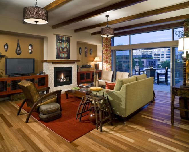 An eclectic family room design with sliding glass doors