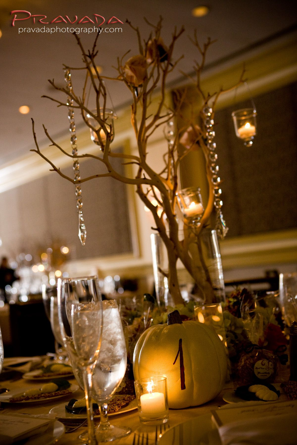 like the manzanita branch centerpieces and pumpkins as