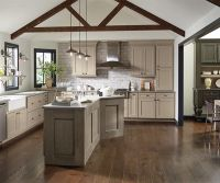 These taupe kitchen cabinets are shown with perimeter